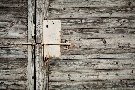 Old latch with padlock on doors Stock Photo - 11173595