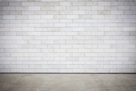 concrete blocks: Tiled wall with a blank white bricks   Stock Photo