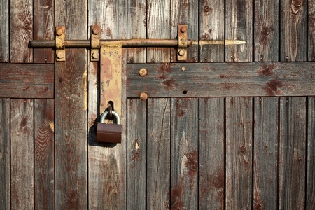 iron gate: Old latch with padlock on doors