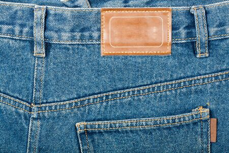 Blank leather jeans label sewed on a blue jeans.    photo