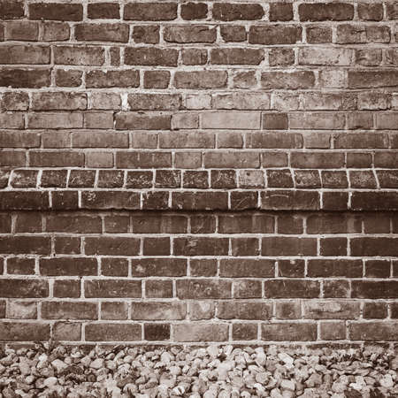 Old brick wall background, sepia version photo