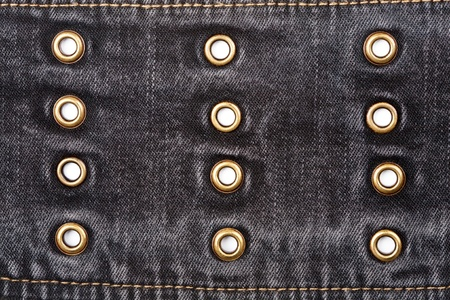 Worn black jeans texture with rivets photo