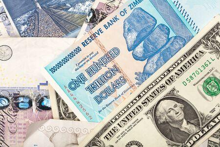 trillion: Money background with US dollars, British pounds, Lithuanian litas and Zimbabwe hundred trillion dollars