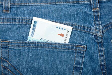trillion: One hundred trillion dollars in jeans pocket   Stock Photo
