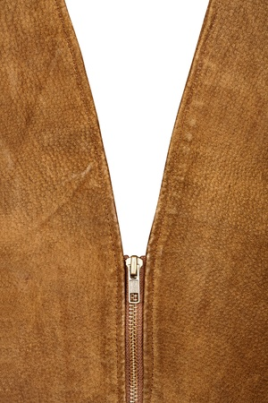 Fragment of brown suede vest isolated on white photo
