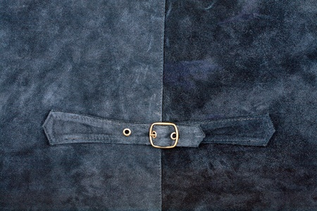 Fragment of suede vest back with metal buckle