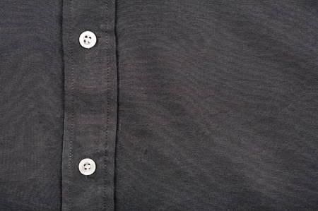 buttonhole: Black shirt with buttons detailled texture