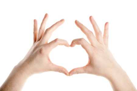 Female hands making heart sign isolated on white background photo