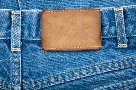 Blank real leather jeans label on a blue jeans.     photo