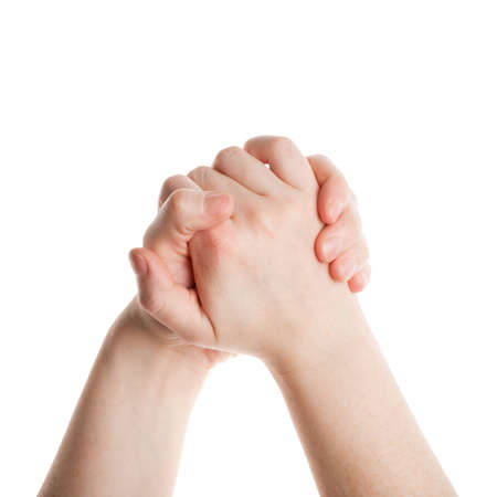Woman hands holding each other isolated on white background  photo