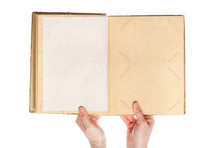 Opened vintage photo album in hands isolated on white background  photo