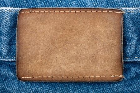 Blank leather jeans label sewed on a blue jeans Foto de archivo