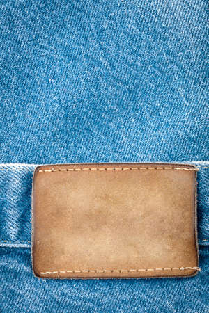 Blank leather jeans label sewed on a blue jeans  photo