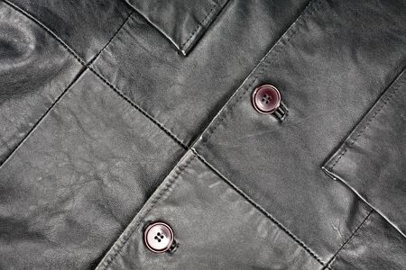 Fragment of black leather jacket   photo
