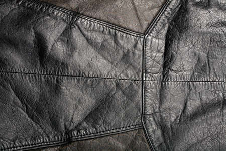Scratched worn leather texture with seam     photo