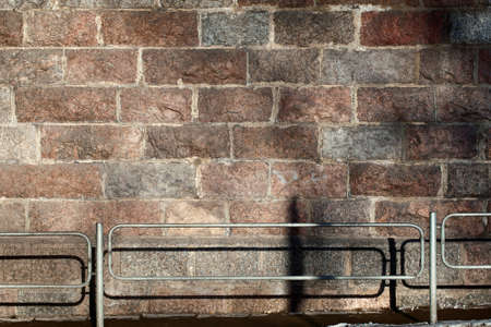 Stone wall and metal fence photo