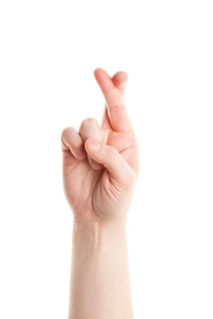 cross arms: Finger crossed hand sign isolated on white background