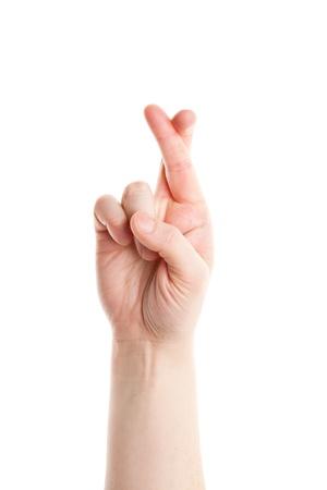 mani incrociate: Incrociamo le dita mano segno isolato su sfondo bianco