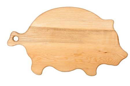 Pigs shape chopping board isolated on white
