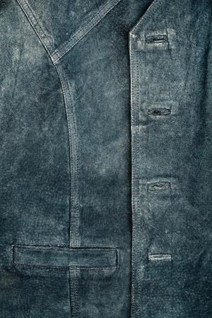 Old worn suede vest fragment with side pocket Stock Photo - 12509913