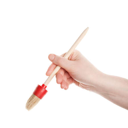Hand with a brush isolated on white background Stock Photo - 12509793