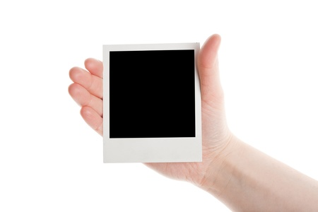 One instant photo in hand isolated on white background  Foto de archivo