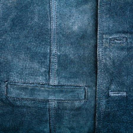 Old worn suede vest fragment with side pocket Stock Photo - 12842599