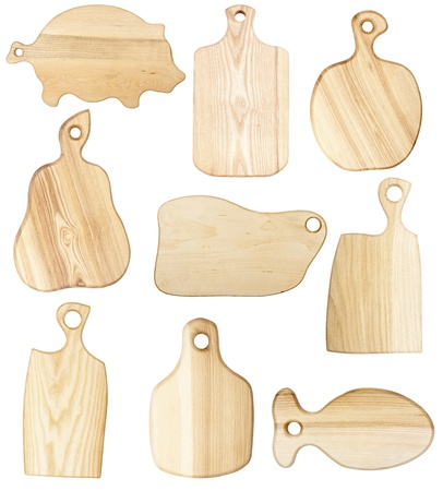 Set of chopping boards isolated on white photo