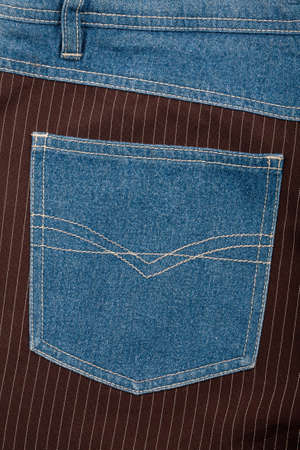 Jeans and lined brown fabric textures with jeans back pocket photo