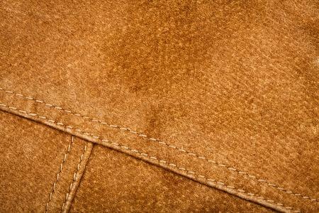 Scratched worn suede texture with seam    Foto de archivo