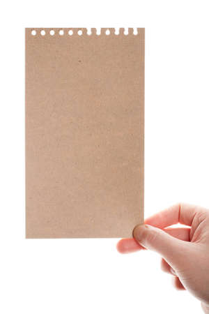Handmade paper card in woman hand isolated on white background   photo