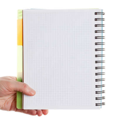 Gesture of hand holding spiral notebook isolated over white background  photo