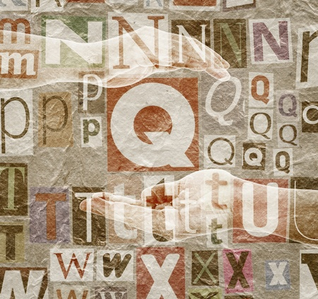 Abstract designed background made of newspaper letters clippings, hands and paper texture photo