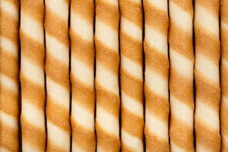 Close-up of striped wafer rolls photo