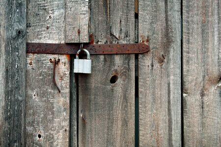 Old latch with padlock on doors   photo
