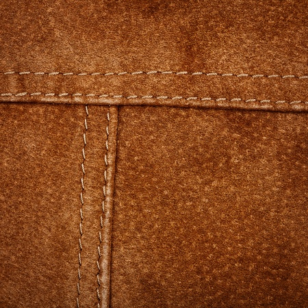 Scratched worn suede texture with seam     photo