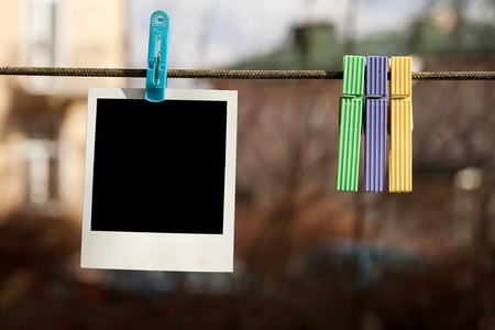 Blank instant photo hanging on clothesline