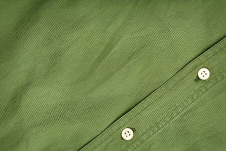 Green fabric texture with buttons background  photo