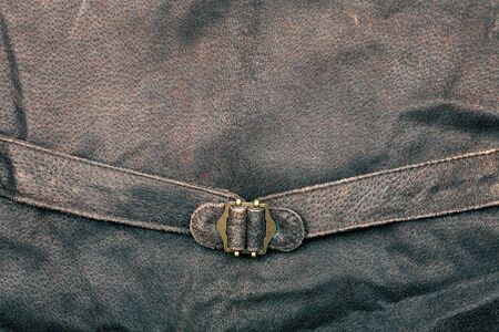 Fragment of suede vest back with metal buckle Stock Photo - 12842797