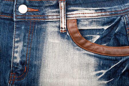 Closeup shot of blue worn jeans front photo