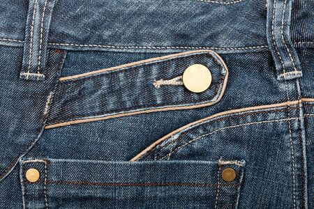 worn jeans: Blue jeans fabric with pocket background