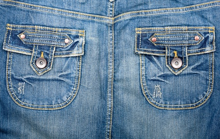 worn jeans: Blue jeans fabric with pockets background