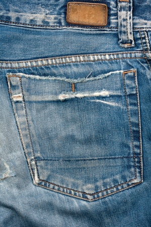 Blank leather jeans label sewed on a blue jeans. Imagens