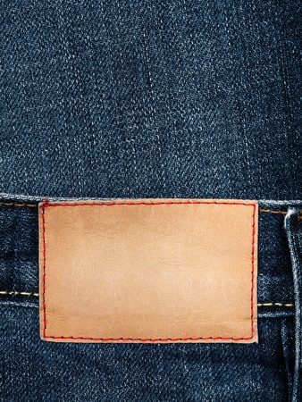 inner wear: Blank leather jeans label sewed on a blue jeans