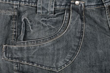 Grey jeans fabric with pocket background  photo