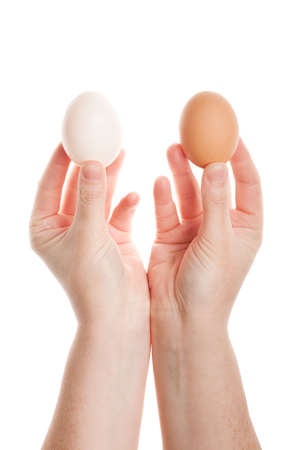 Female hands with eggs isolated on white background  photo