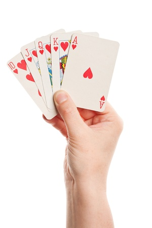 Playing cards in hand isolated on white background  Foto de archivo