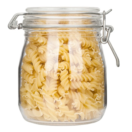Pasta in glass jar on a white background  Imagens