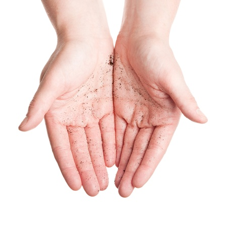 Dirty female palms isolated on white background  photo