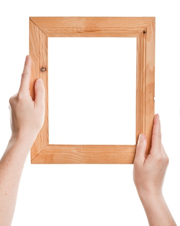 Wooden frame in hands isolated on white background  photo